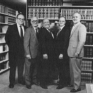 1975: Firm becomes Hughes Thorsness Gantz Powell & Brundin; pictured left to right Dave Thorsness, John Hughes, Dick Gantz, Jim Powell and Brian Brundin circa 1987